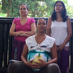 two doulas and one pregnant woman at doula training