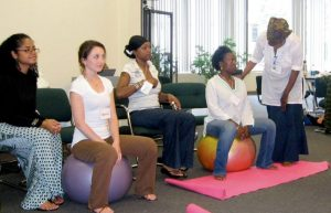 Shafia Monroe teaching a doula training class