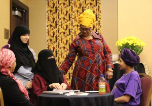 Shafia Monroe leading a small group discussion among Muslim women about cultural competency