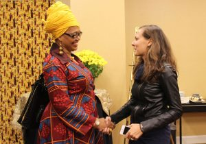 Shafia Monroe and a cultural competency health practitioner shaking hands