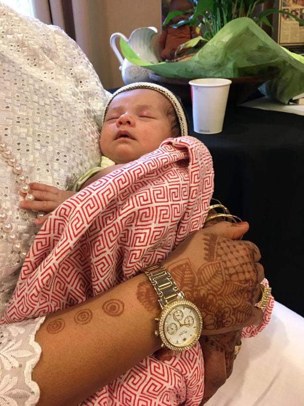 Shafia Monroe holding a newborn baby