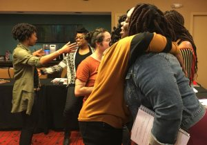 Hugging goodbye in a Full Circle Doula class